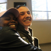Two Teens Members of Substance Free Youth Hugging and Smiling For The Camera
