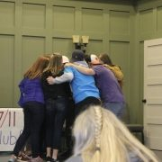 Group of Teenage Substance Free Youth Members Huddle Together During A Performance